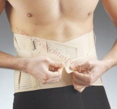 Krustu jostas daļas ortoze, 26 cm, M izmērs, brūna.