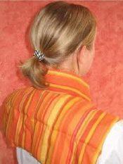 Siltuma spilventiņš muguras kakla daļai.